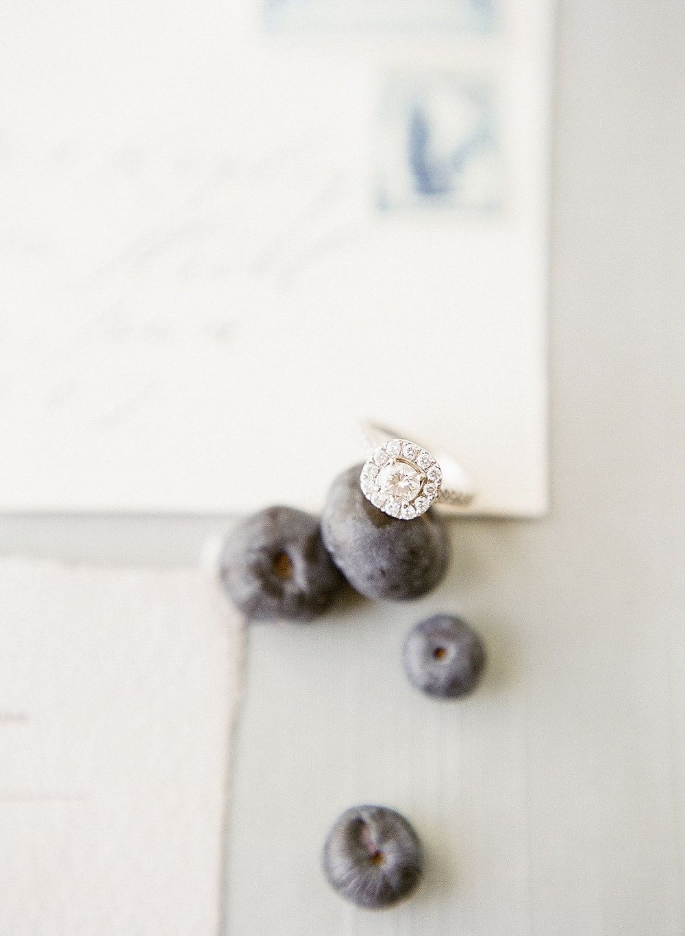 detail of wedding ring and blueberries