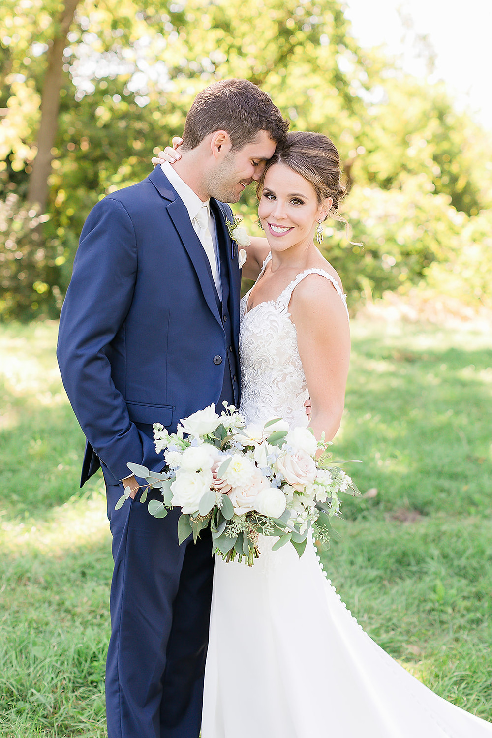 Studio Bloom Iowa bridal bouquet held by couple at Rapid Creek Cidery