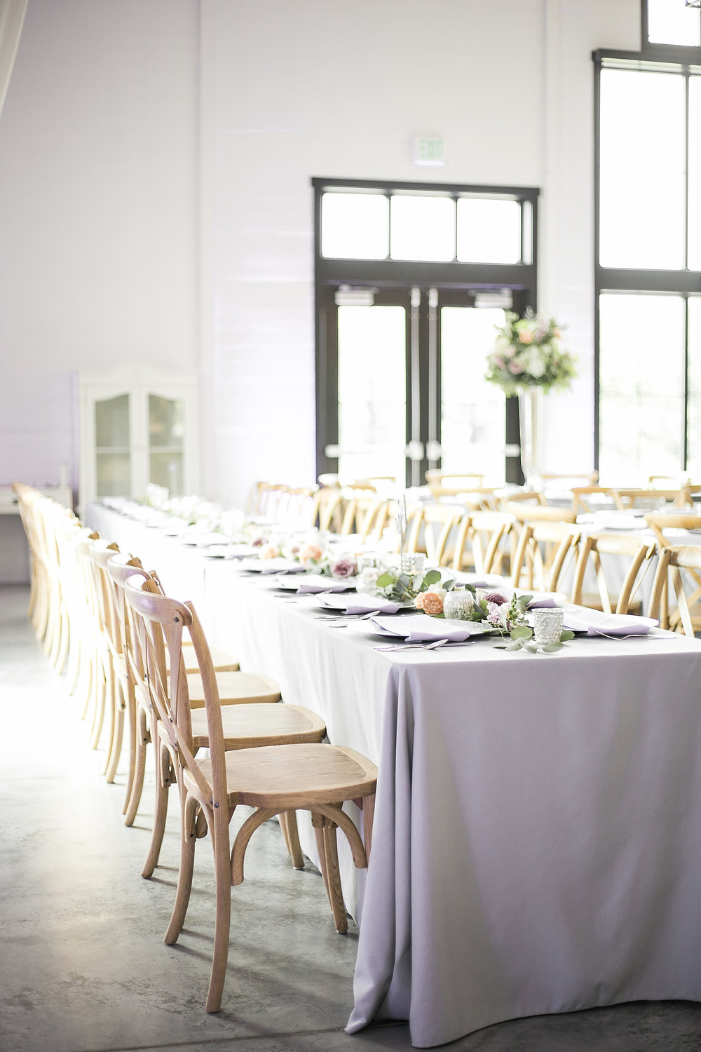 Long guest table at ashton hill wedding reception with eucalyptus and flower garland by studio bloom iowa