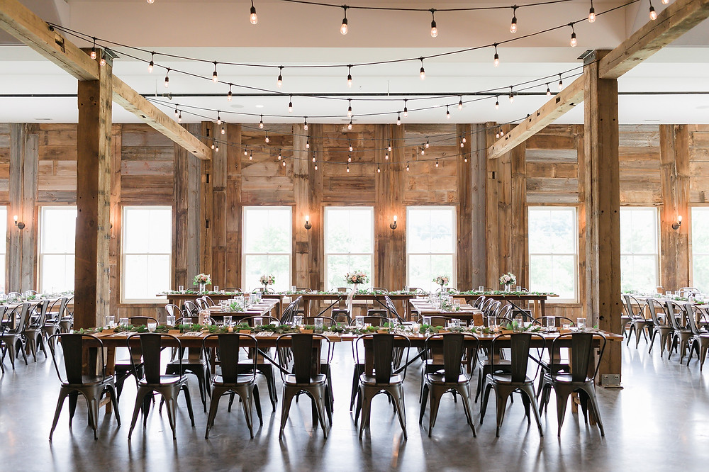 Wedding reception at Rapid Creek Cidery modern barn venue in Iowa City, Iowa