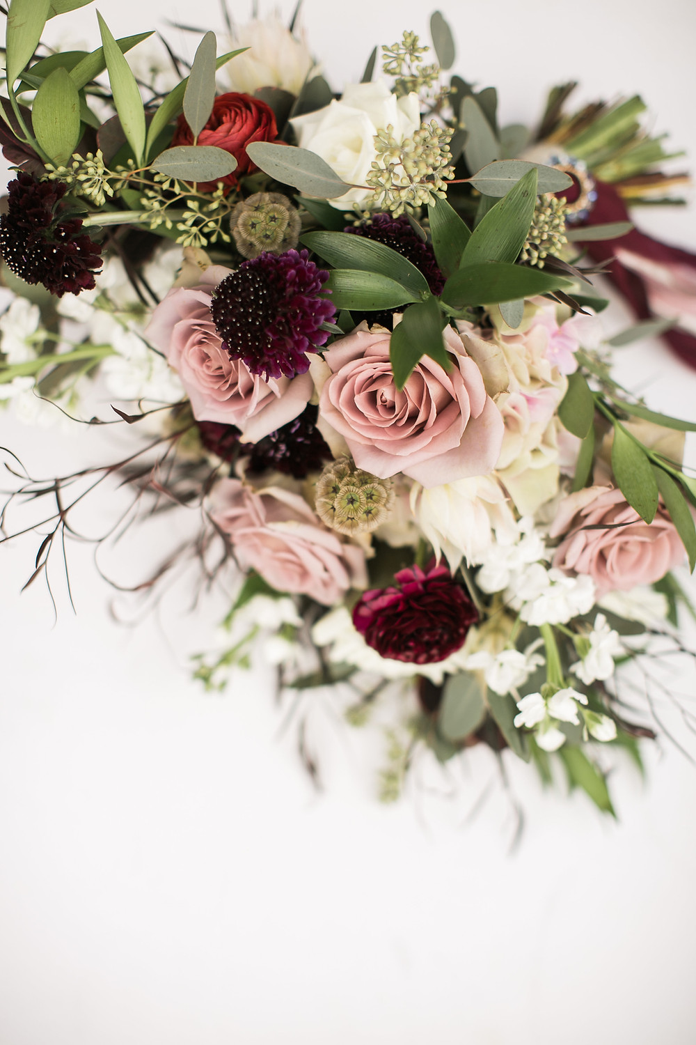 studio bloom iowa wedding florist bridal bouquet in mauve, burgundy, and white with roses, scabiosa, ranunculus, and greenery