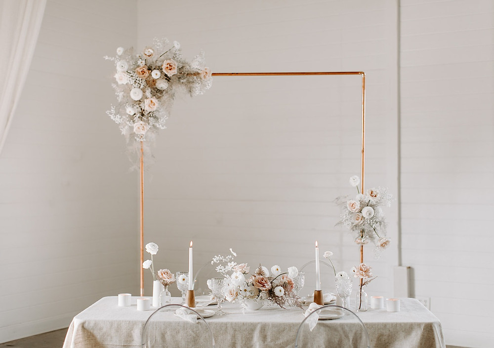 Studio Bloom Iowa wedding flowers with modern copper and white reception decorations