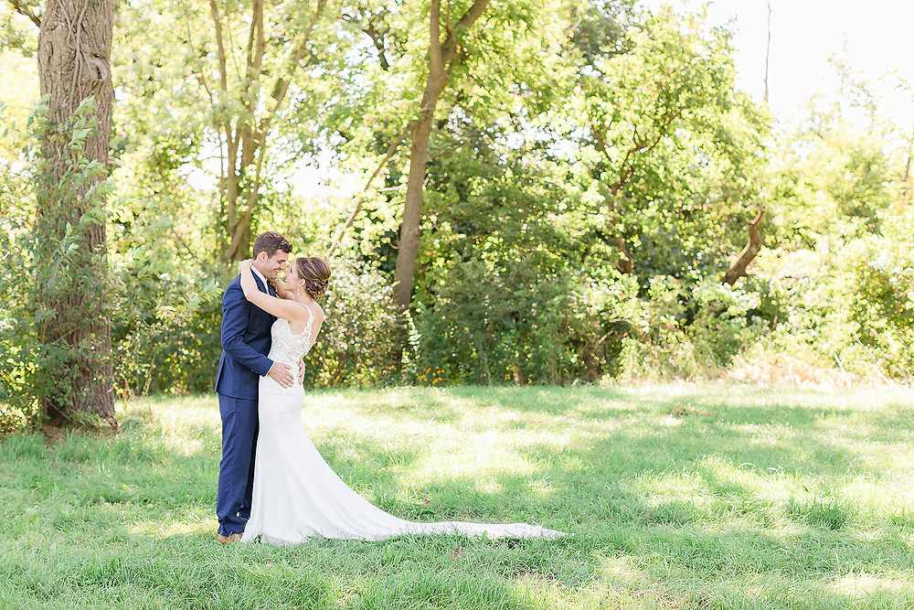 bride and groom outdoors at Rapid Creek Cidery in Iowa City
