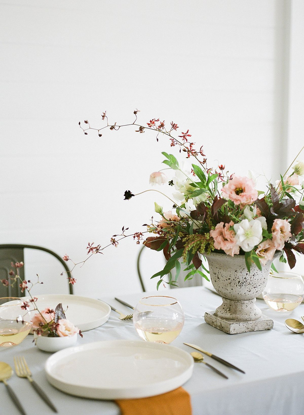 muted minimalist wedding centerpiece by Studio Bloom Iowa with orchids, lisianthus, and hellebores