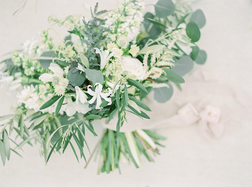 green and white spring bridal elopement bouquet by studio bloom iowa wedding florist