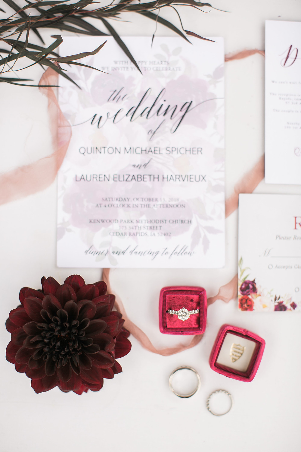 burgundy dahlia with wedding invitation suite, rings, and burgund mrs box