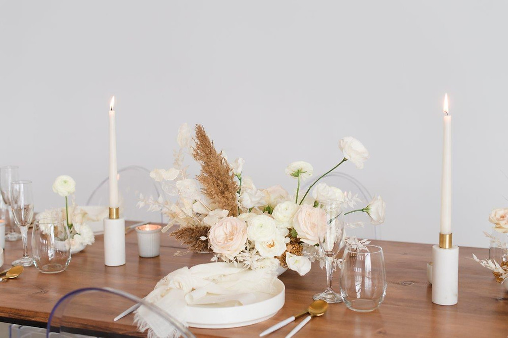 Minimalist wedding centerpiece by Studio Bloom Iowa at Little Lights on the Lane in West Branch on wood farm table
