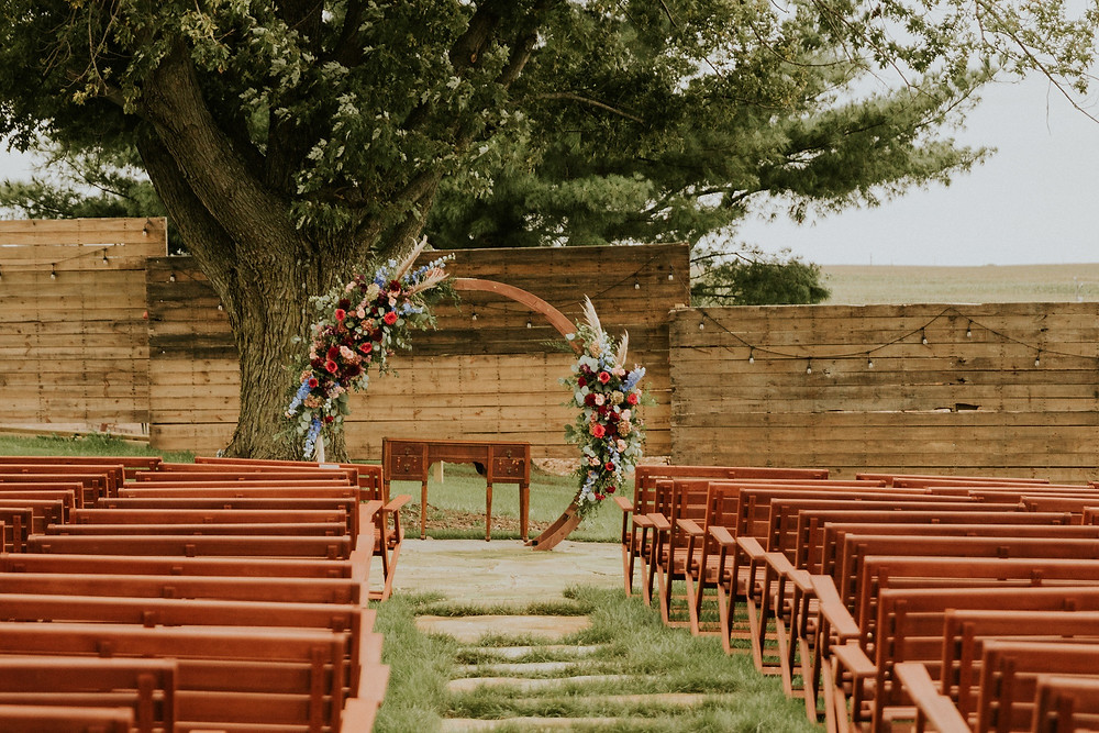 Studio Bloom Iowa moongate circle arch for wedding ceremony at Little Lights on the Lane