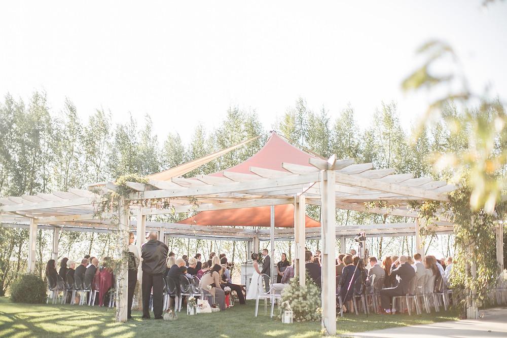 outdoor wedding ceremony at sutliff cider in lisbon iowa
