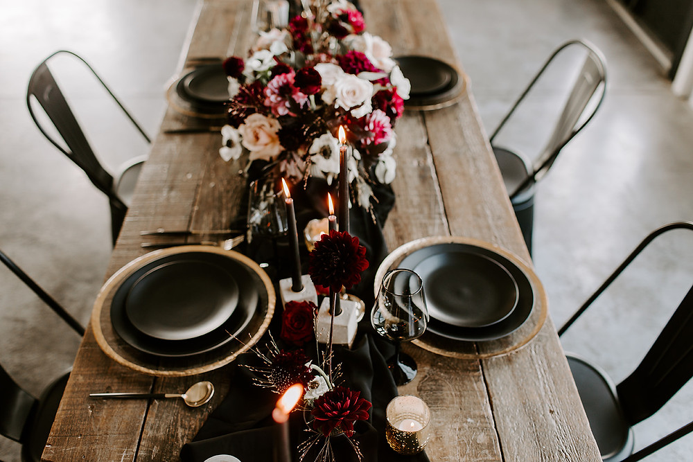dramatic burgundy and black wedding head table flowers by Studio Bloom Iowa florist
