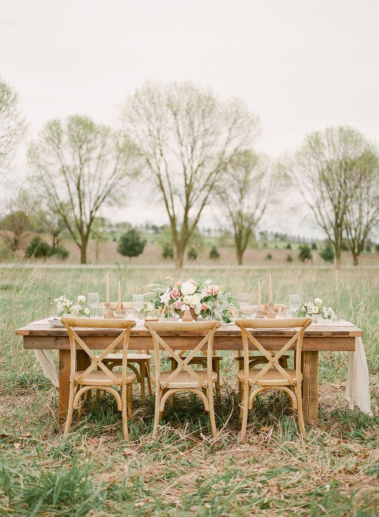 Studio Bloom Iowa Farm to table wedding centerpiece on wood farmhouse table