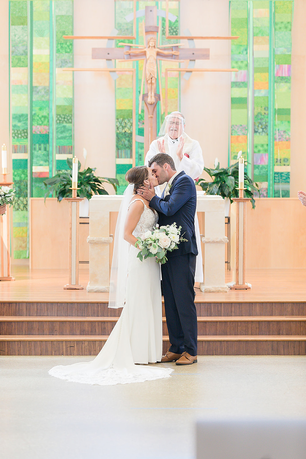 bride and groom married at St Thomas More Church Coralville flowers by Studio Bloom Iowa