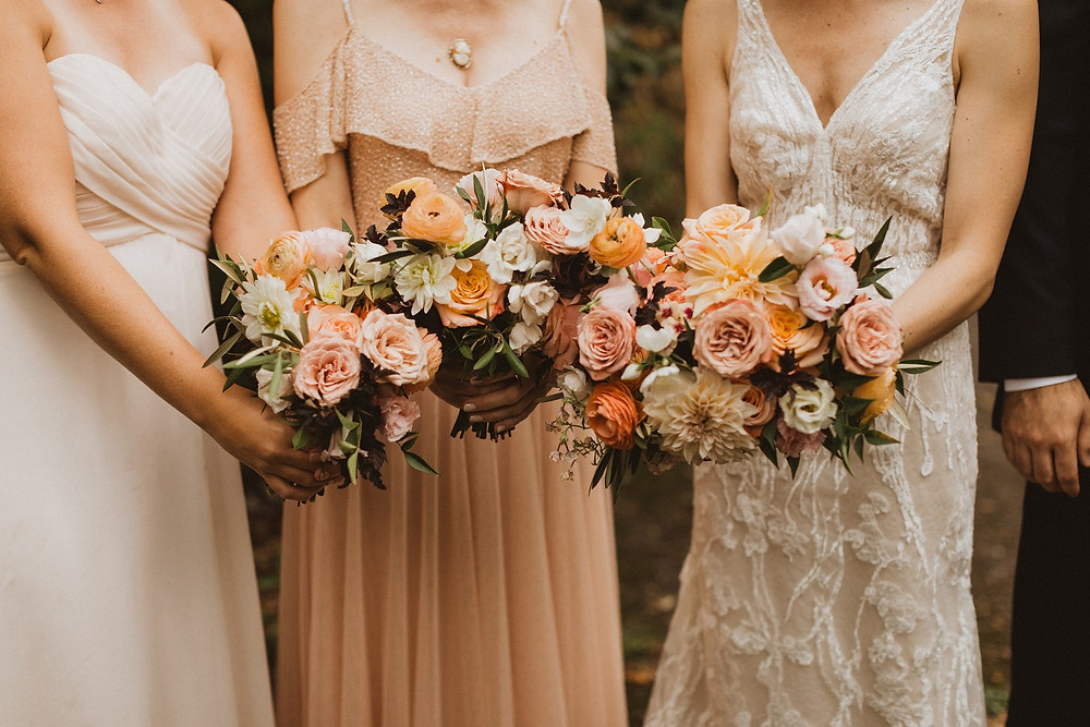 garden bridal and bridesmaids bouquets in peach and nude by Studio Bloom Iowa