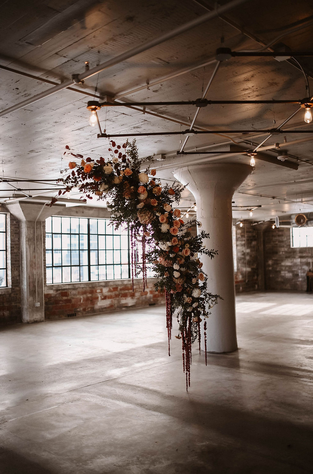 Studio Bloom Iowa hanging floral installation for wedding ceremony at the HarMac
