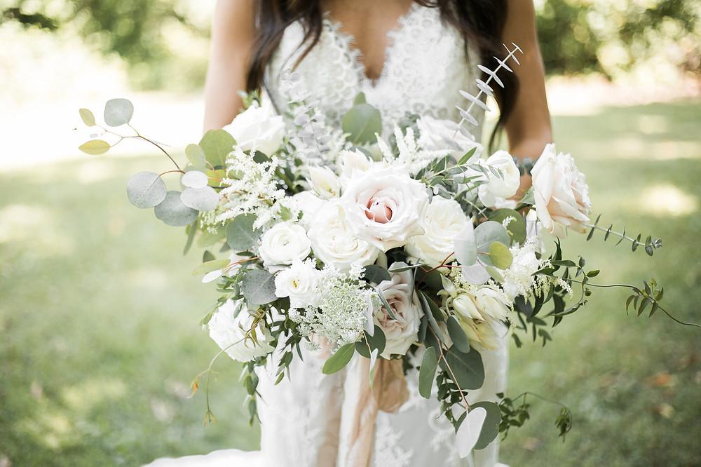 bridal bouquet by studio bloom iowa wedding florist with blush roses, white ranunculus, astilbe, blushing bride, eucalyptus