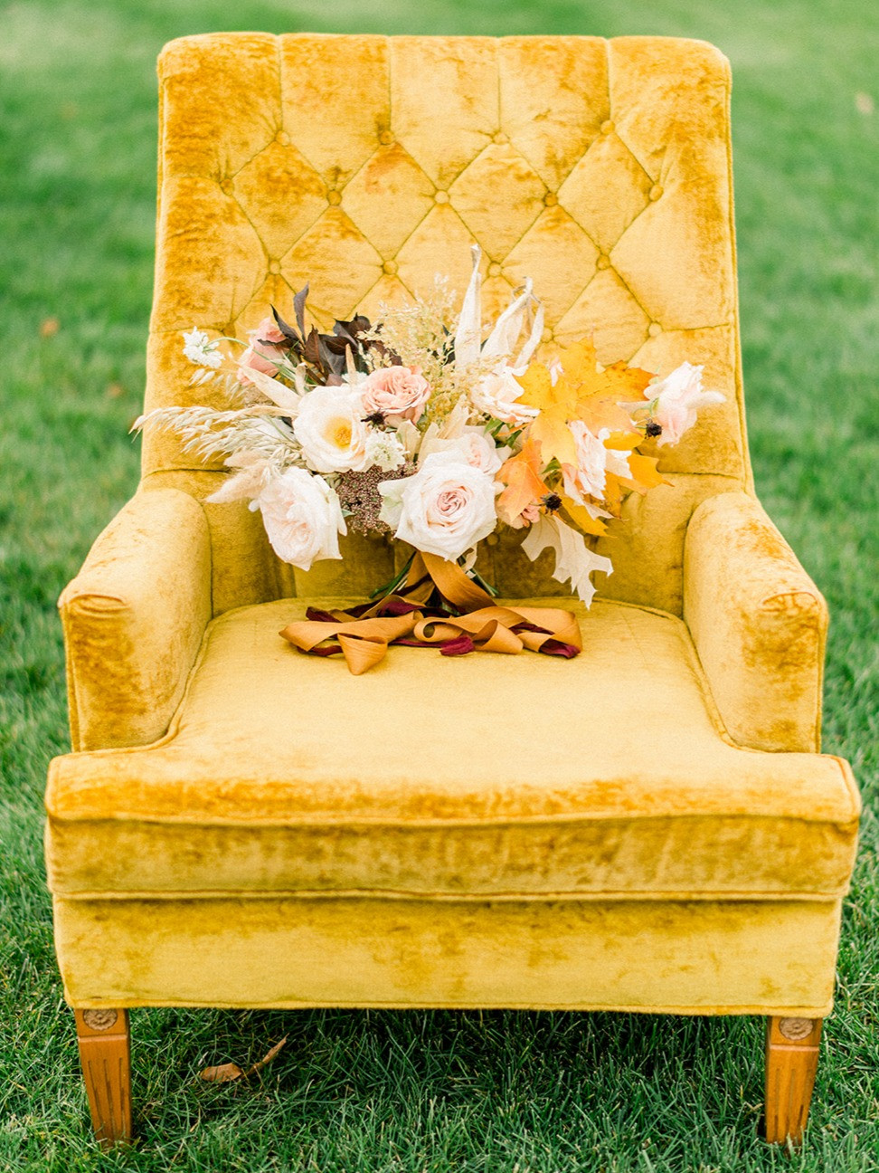 vintage mustard yellow velvet chair with fall bridal bouquet by studio bloom iowa