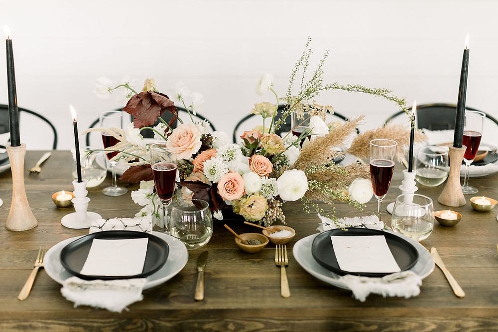 Floral centerpiece by Studio Bloom Iowa with pampas, roses, ranunculus for modern wedding in neutral tones at Walker Homestead