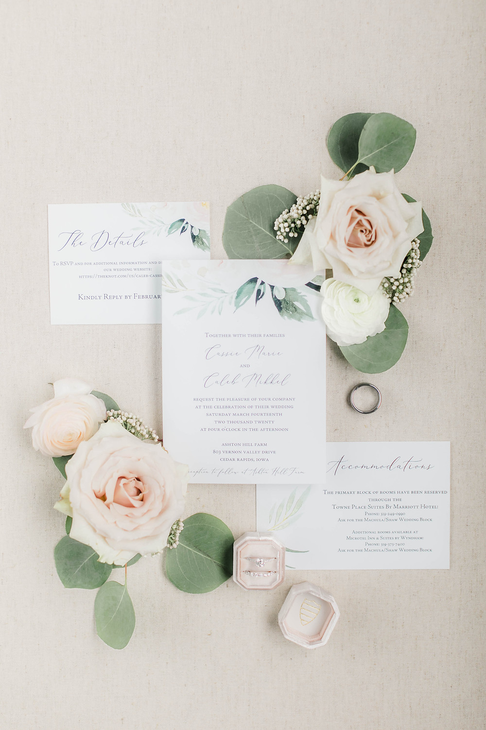 Wedding invitation suite with greenery and blush flower accents
