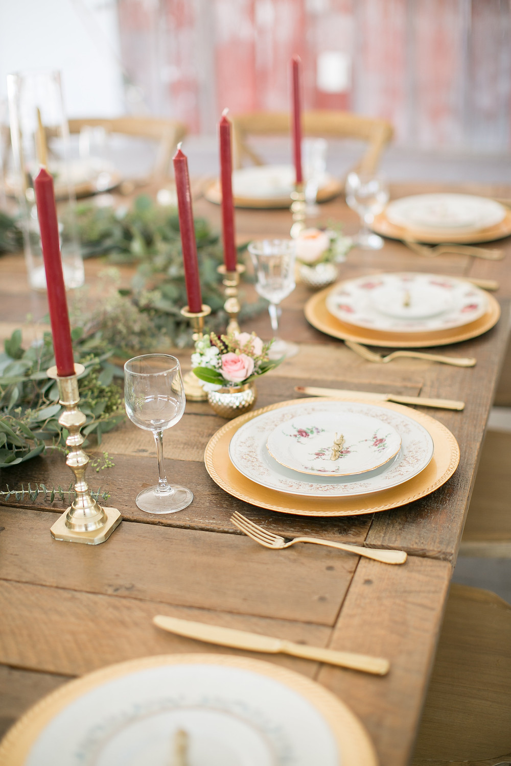barnwood table with candles and vintage china set for wedding reception at sutliff cider