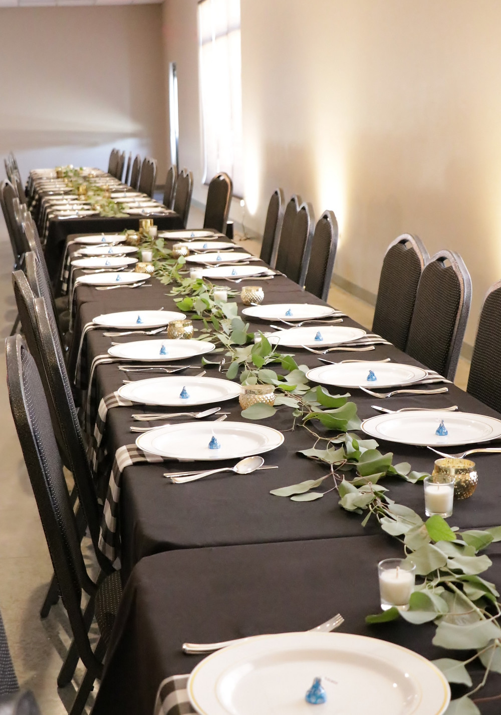 eucalyptus runner on black tablecloth with gold votives and buffalo check napkins for wedding at Waucoma Event Center