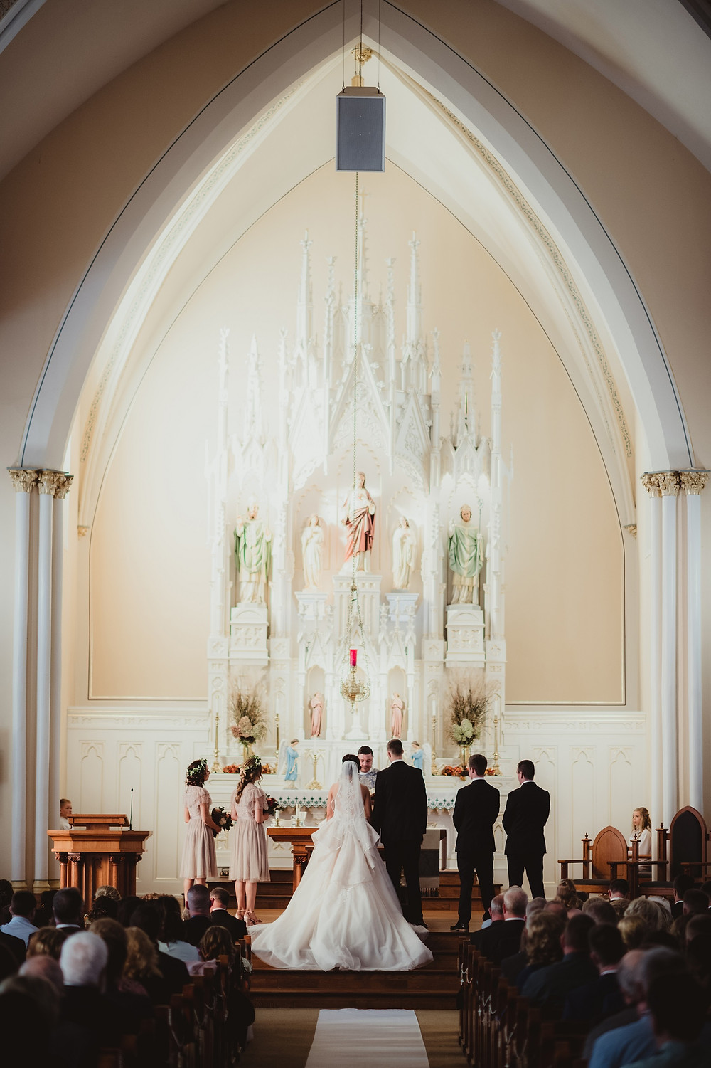 wedding ceremony at St Matthias catholic church in cascade, iowa.