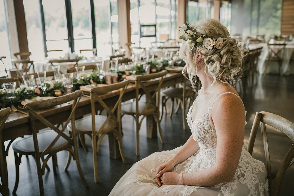 bride with rose flower crown by studio bloom iowa anticipating her wedding at terry trueblood lodge in iowa city