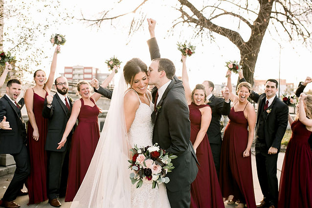 studio bloom iowa bride and groom with bouquets in blush and burgundy