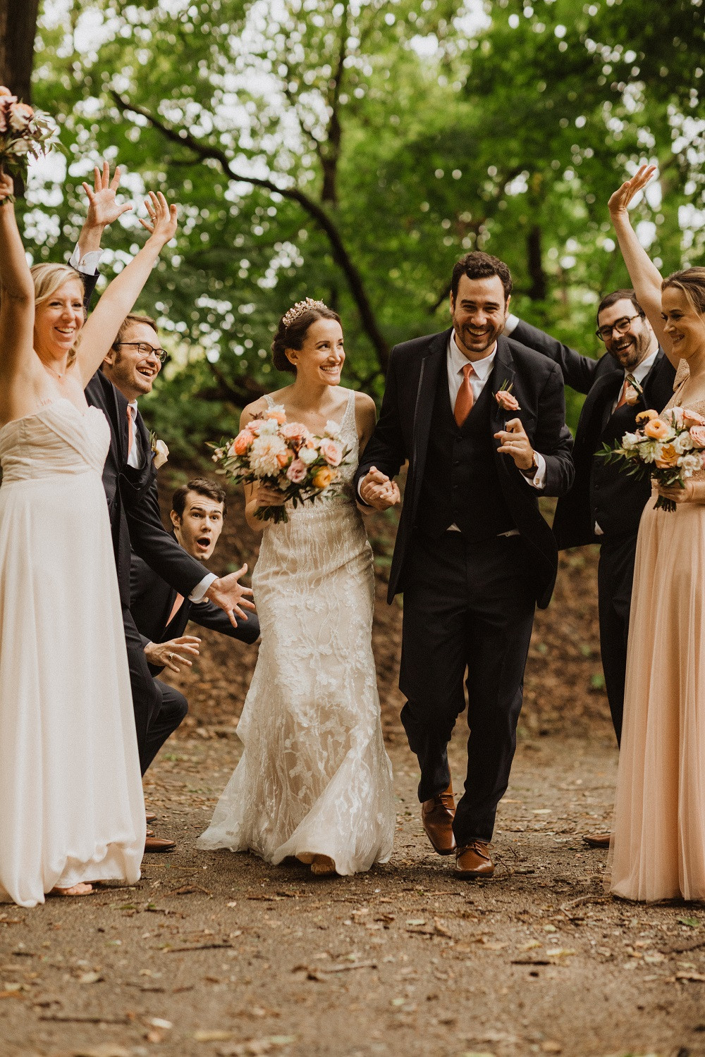 bride and groom with peach and blush bridal bouquet by Studio Bloom Iowa
