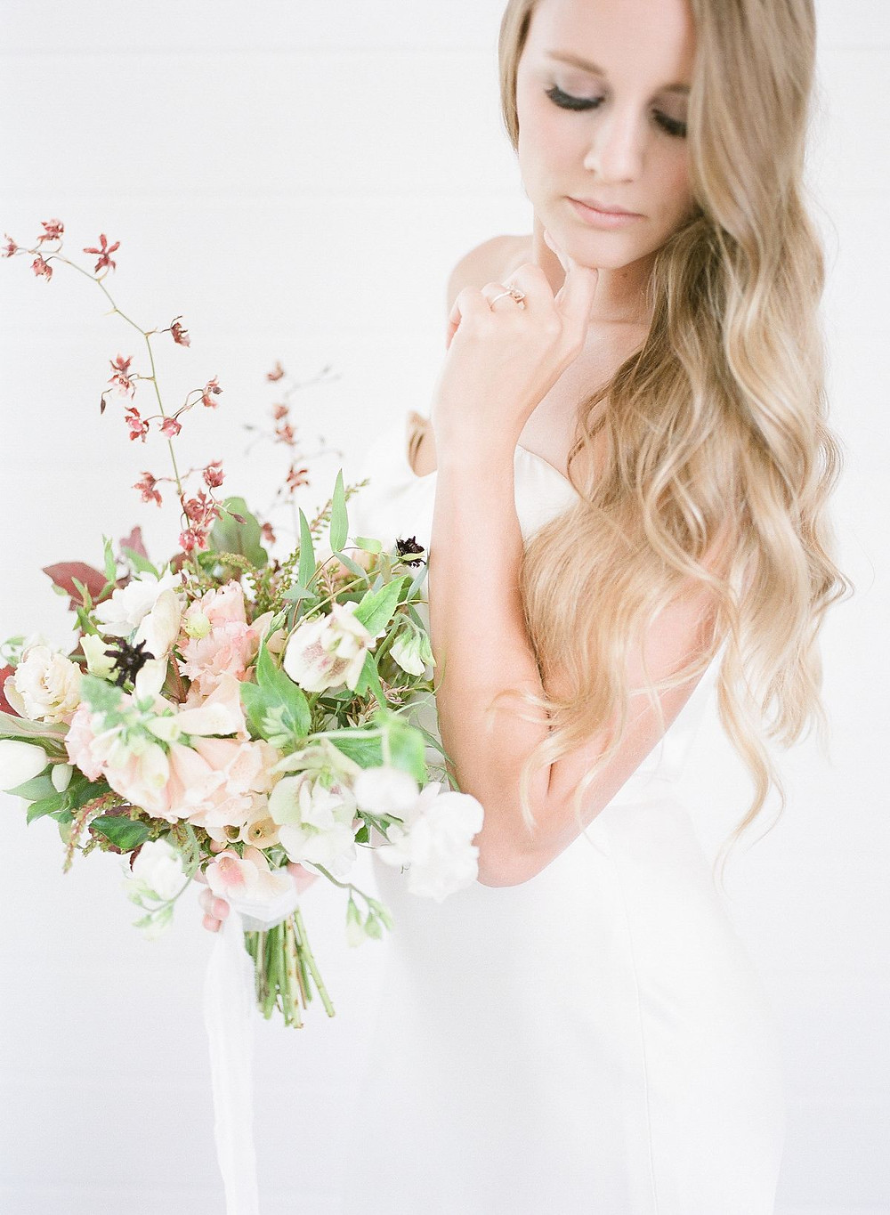 Minimalist bride with Studio Bloom Iowa neutral colored bridal bouquet with foxglove, orchids, lisianthus, and hellebores