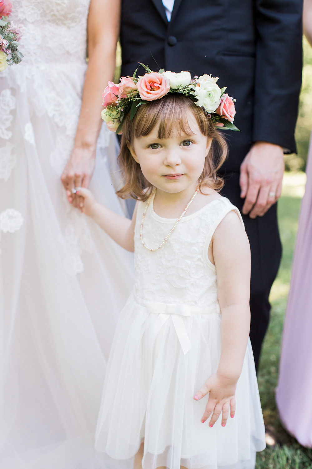 sweet flower girl wearing rose flower crown by studio bloom iowa for romantic summer wedding