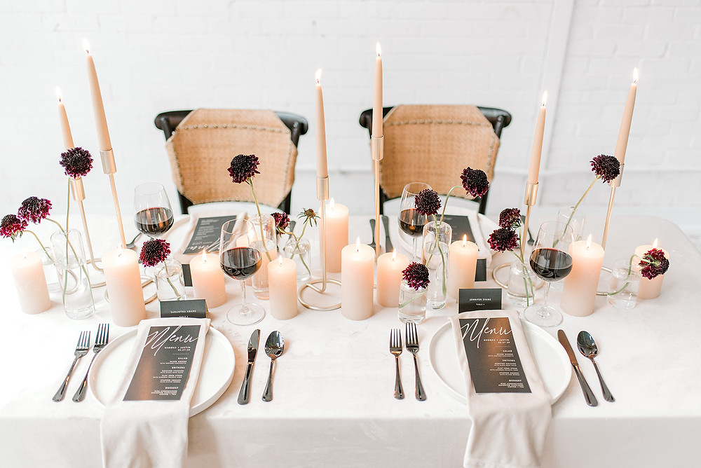 modern minimalist wedding table budvase centerpiece with black scabiosa and pillar candles