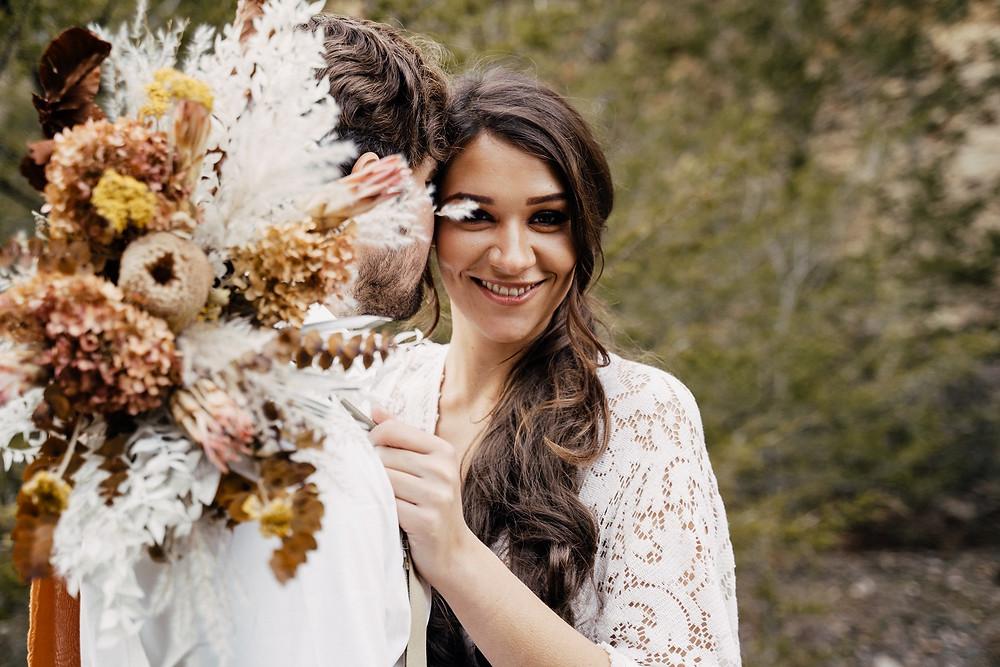 boho bride with dried bouquet by Studio Bloom Iowa wedding flowers