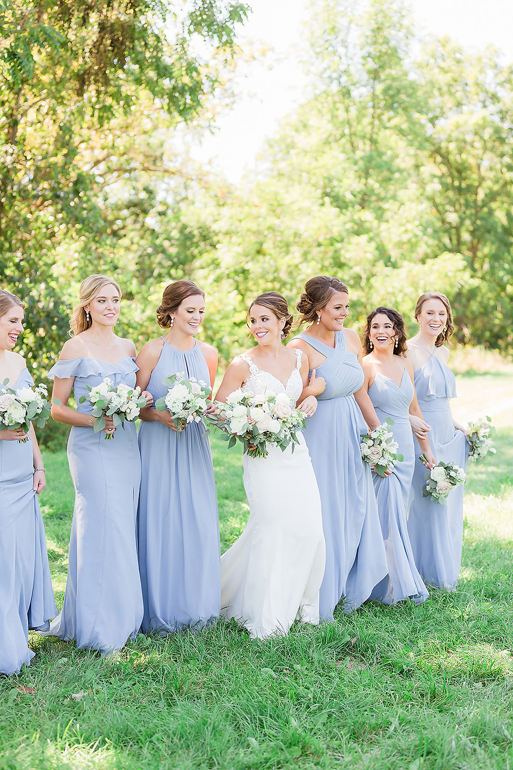 Bride and maids in light blue with Studio Bloom Iowa wedding flowers