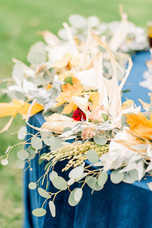 eucalyptus garland with maple and corn shucks by studio bloom iowa wedding florist