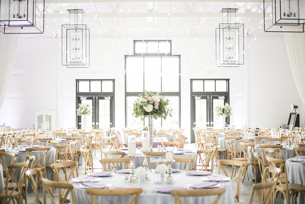 ashton hill farm reception with tall floral centerpieces by studio bloom iowa in lavender and mauve with hydrangea and roses