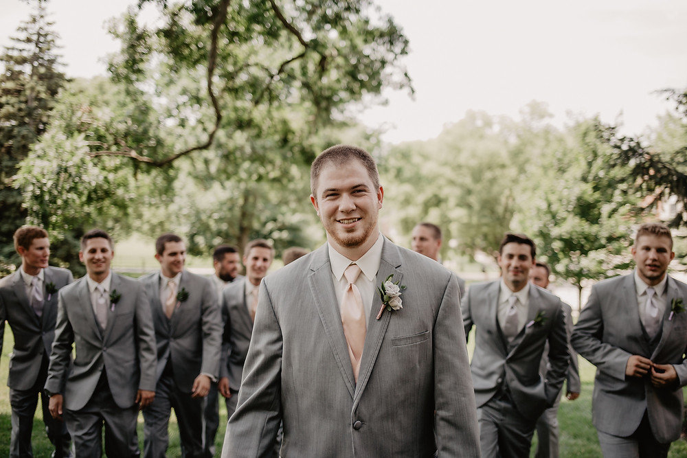 groom and groomsmen in grey suits and blush ties