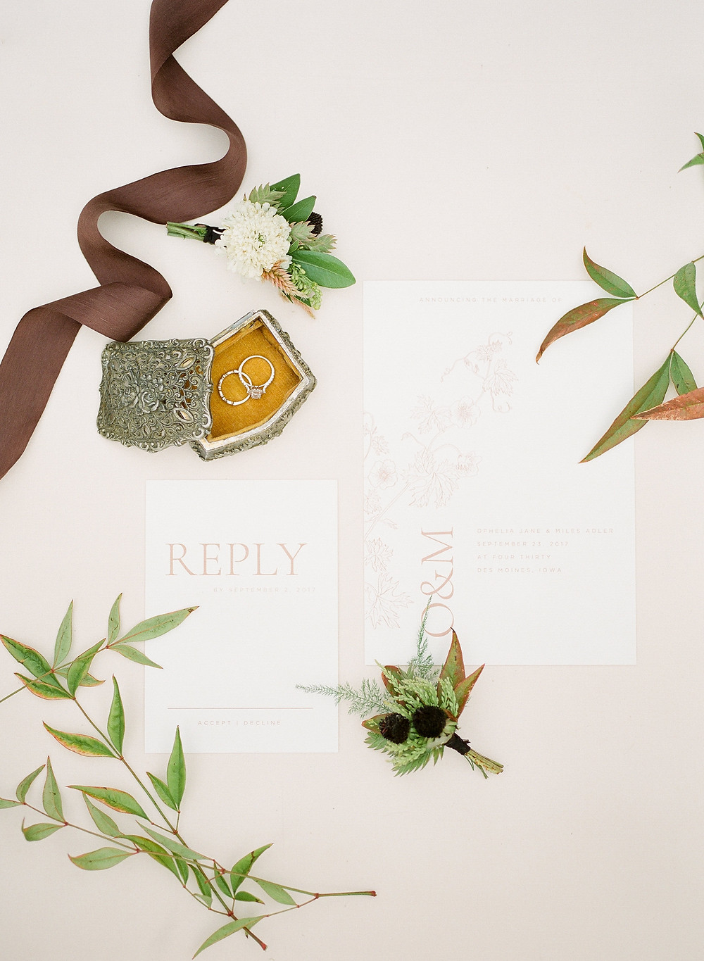 wedding invitation, rings in antique box, and boutonnieres wedding detail shot