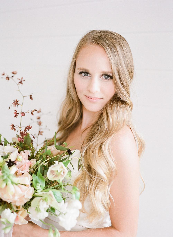 Minimalist bride with Studio Bloom Iowa wedding flowers at Ashton Hill Farm