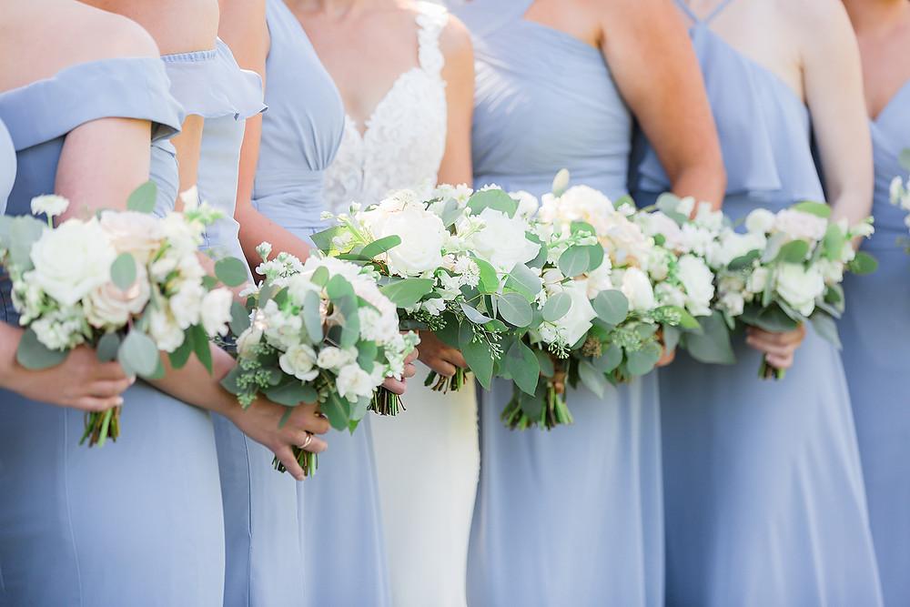 Studio Bloom Iowa bride and bridesmaid bouquets in blush and white