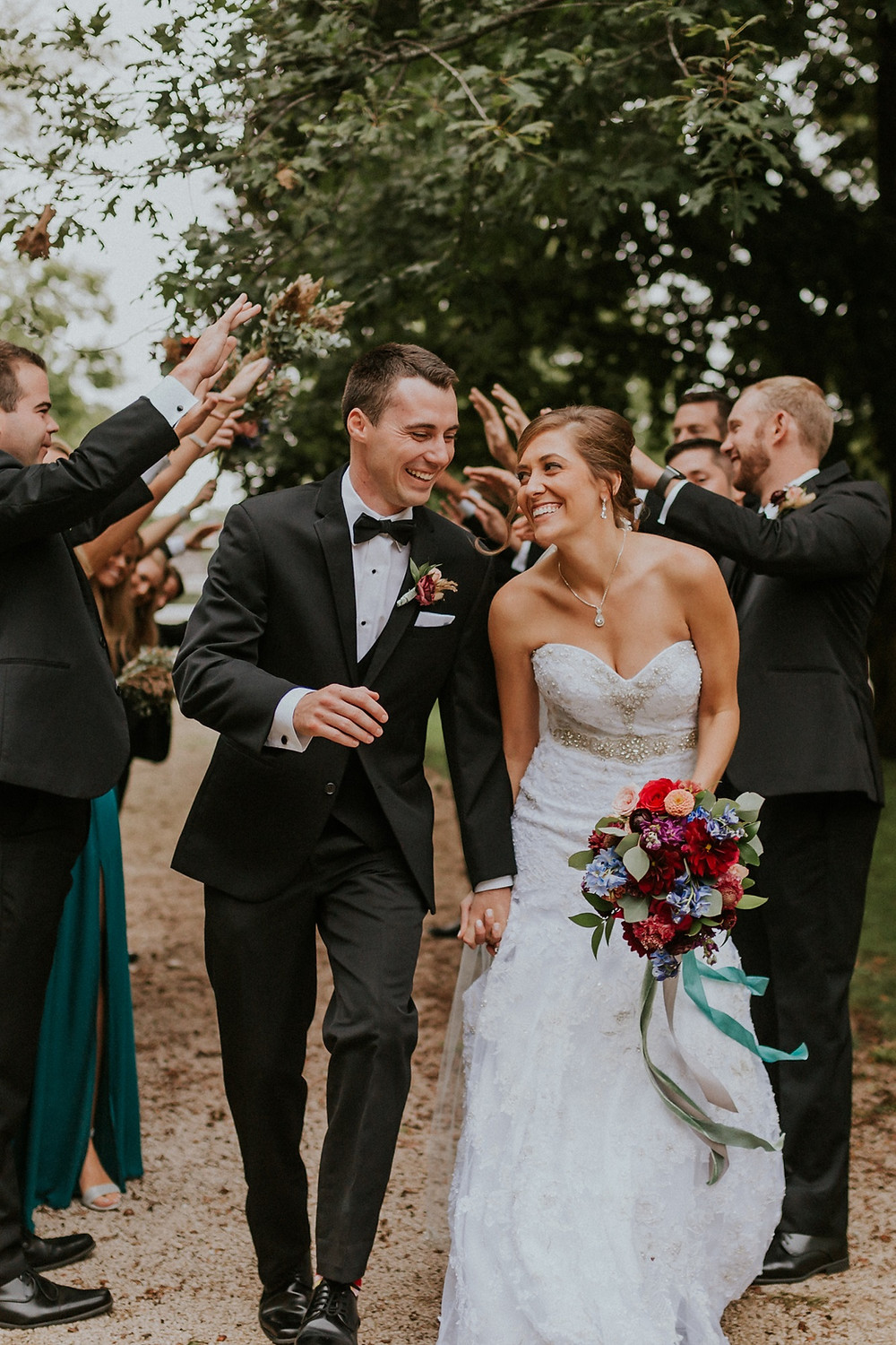 happy couple with jeweltone bridal bouquet by Studio Bloom Iowa