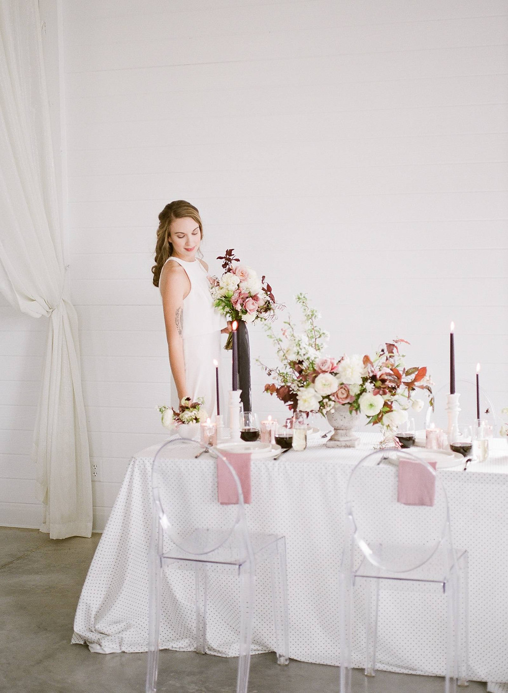 Modern wedding flowers by Studio Bloom Iowa of roses, ranunculus, peonies, plum, and flowering branches in mauve and white