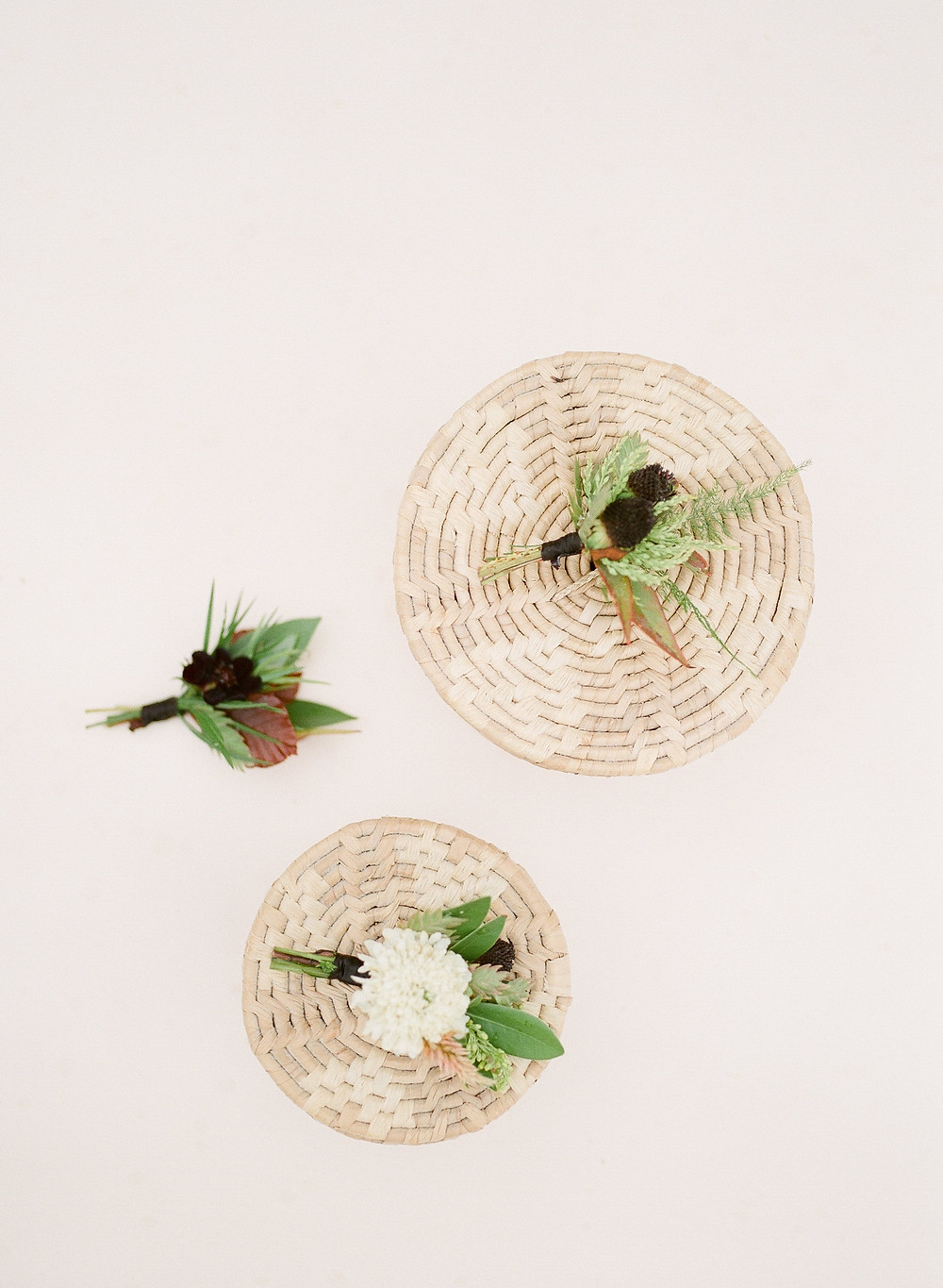 earthy boutonnieres in white and brown by studio bloom iowa