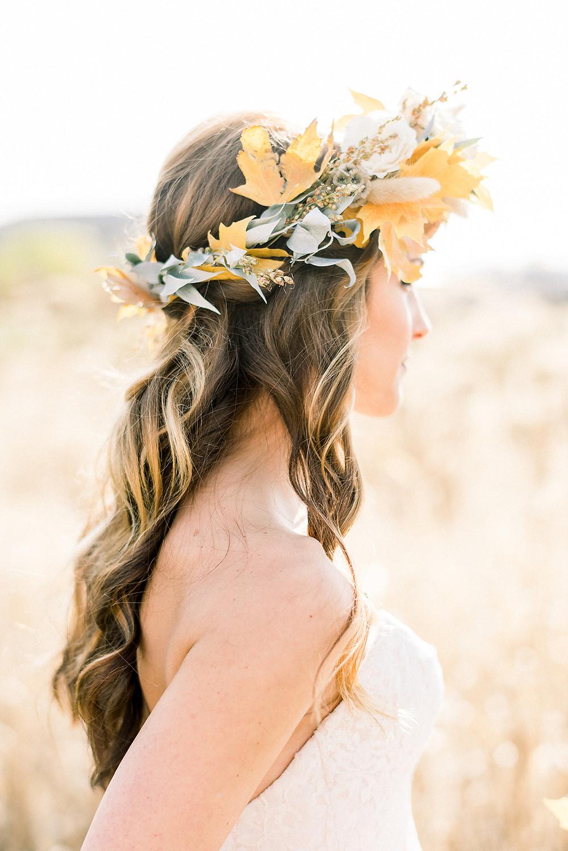 bride awaiting her wedding ceremony wearing maple leaf flower crown by studio bloom iowa
