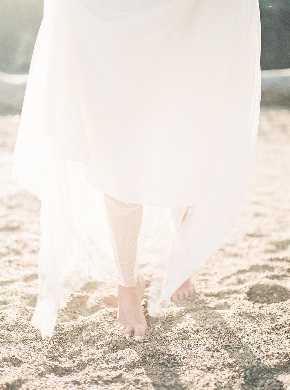 barefoot bride in the sand at Palisades Kepler State Park beach