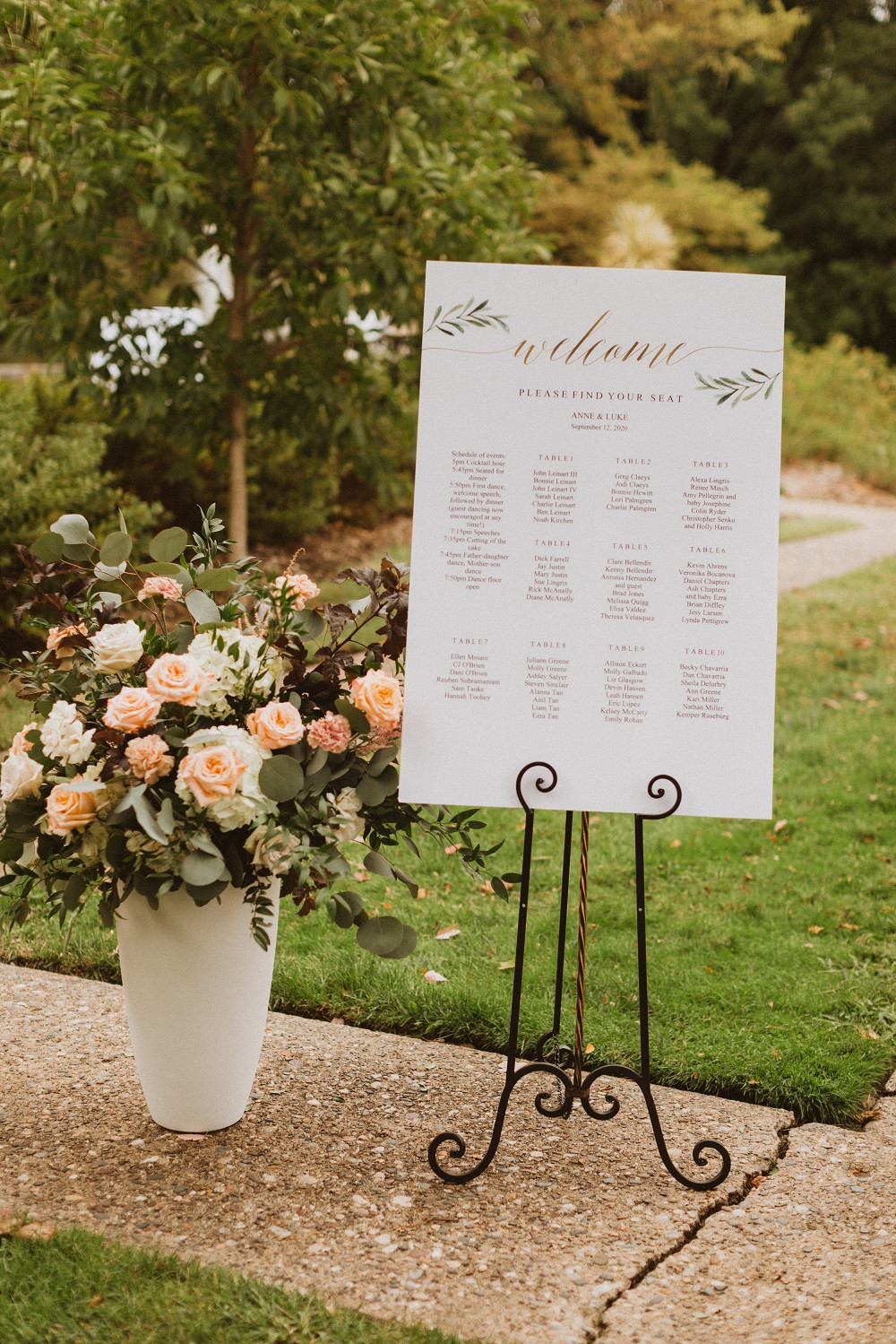 wedding entrance sign with Studio Bloom Iowa large garden arrangement in peach and white