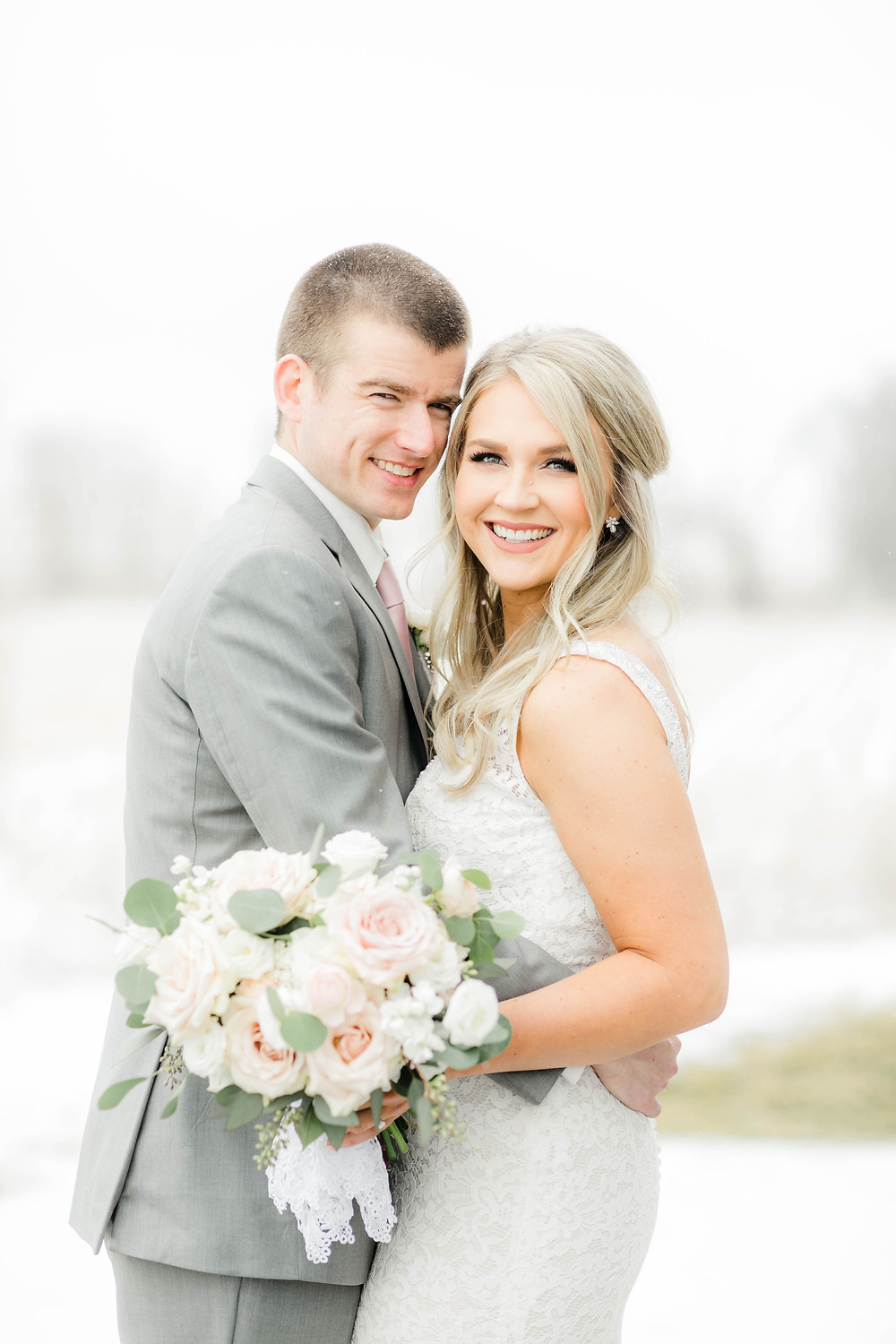 Bride and groom at Ashton Hill Farm with bridal bouquet by wedding florist Studio Bloom Iowa