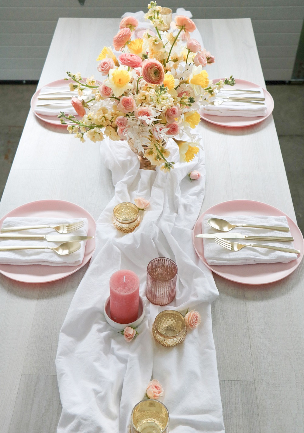 spring table centerpiece by Studio Bloom Iowa in peach, yellow, and cream