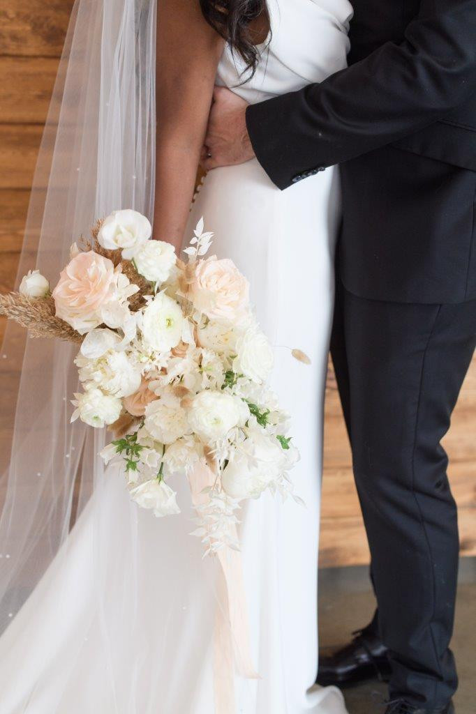 Studio Bloom Iowa weddings white neutral bridal bouquet of garden roses, ranunculus, lisianthus, pampas, and bleached ruscus