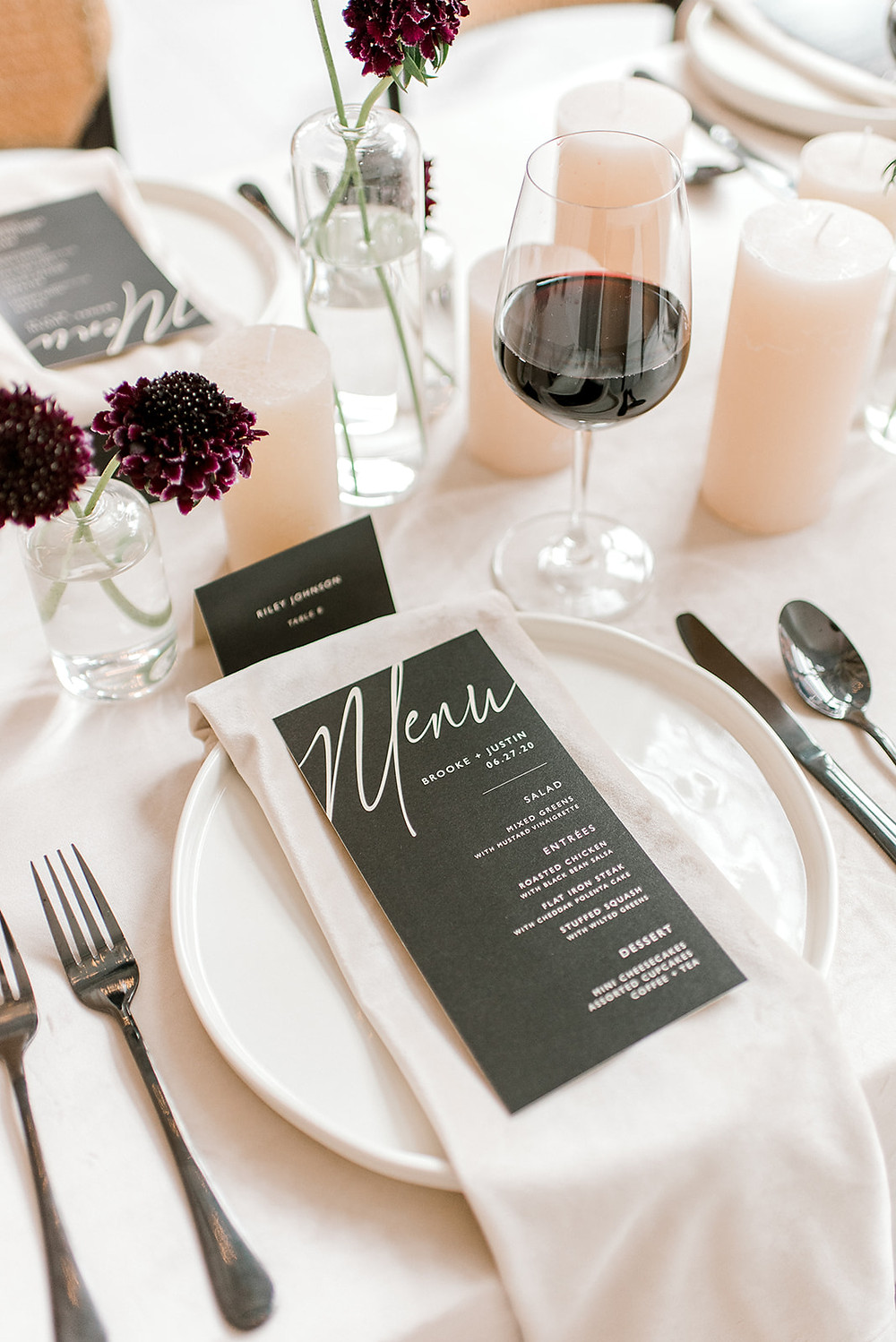 modern neutral minimalist wedding table with black menu card and red wine