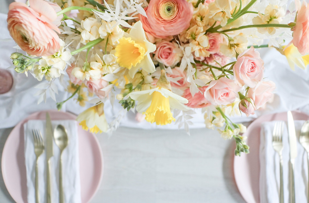 Studio Bloom Iowa florist spring wedding flowers in peach, yellow, and cream